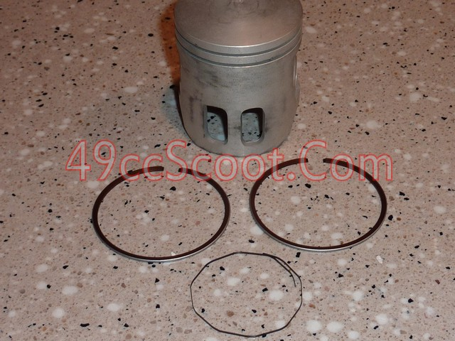 Heres A 2T Piston Kit You Can See The Two Standard Compression Rings And Then That Thing